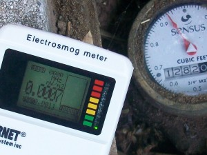 Non-wireless, old-style analog water meter emits zero radiation. Neighborhood has low levels - 0.0007 milliwatts per meter squared, or lower.